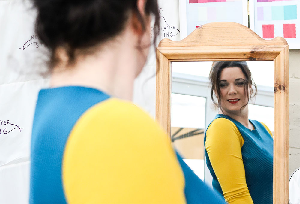 Janine looking at reflection in mirror